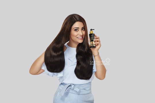 Actress Shriya Saran posing for Hair Tonic product.